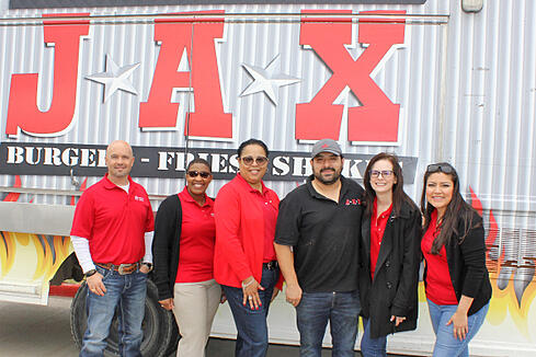 Members Choice employees pose in front of the Jax Burgers food truck