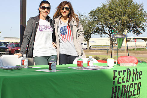 Two community partners help out at the Feed the Hunger table